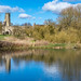 The ruins of St Martin's Church in the deserted medieval village of Wharram Percy, seen across the millpond