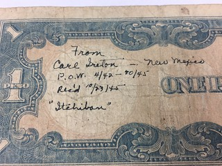 Carl Ireton One Peso inscription closeup