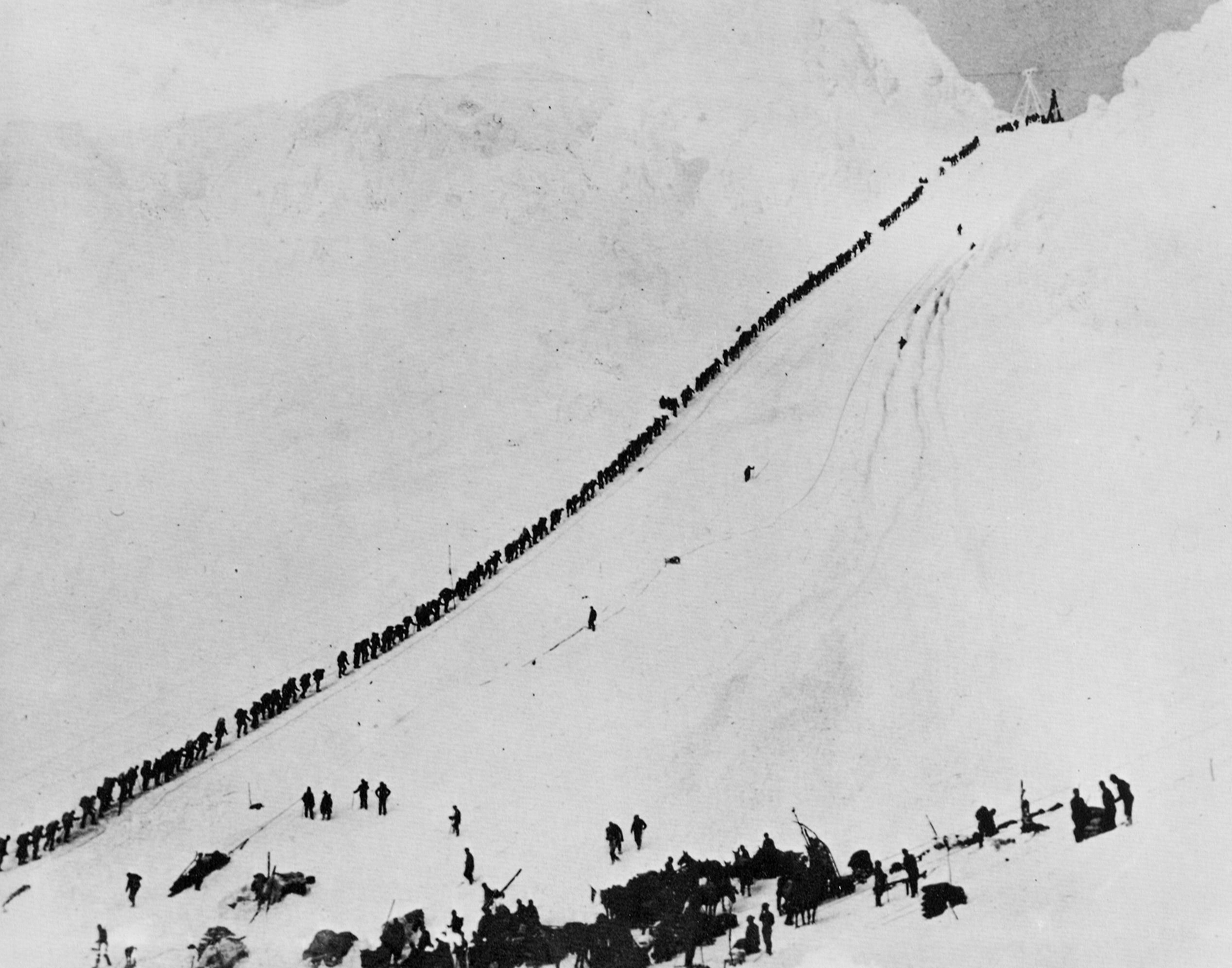 Miners and prospectors climb the Chilkoot Trail during the Klondike Gold Rush, September 1898.