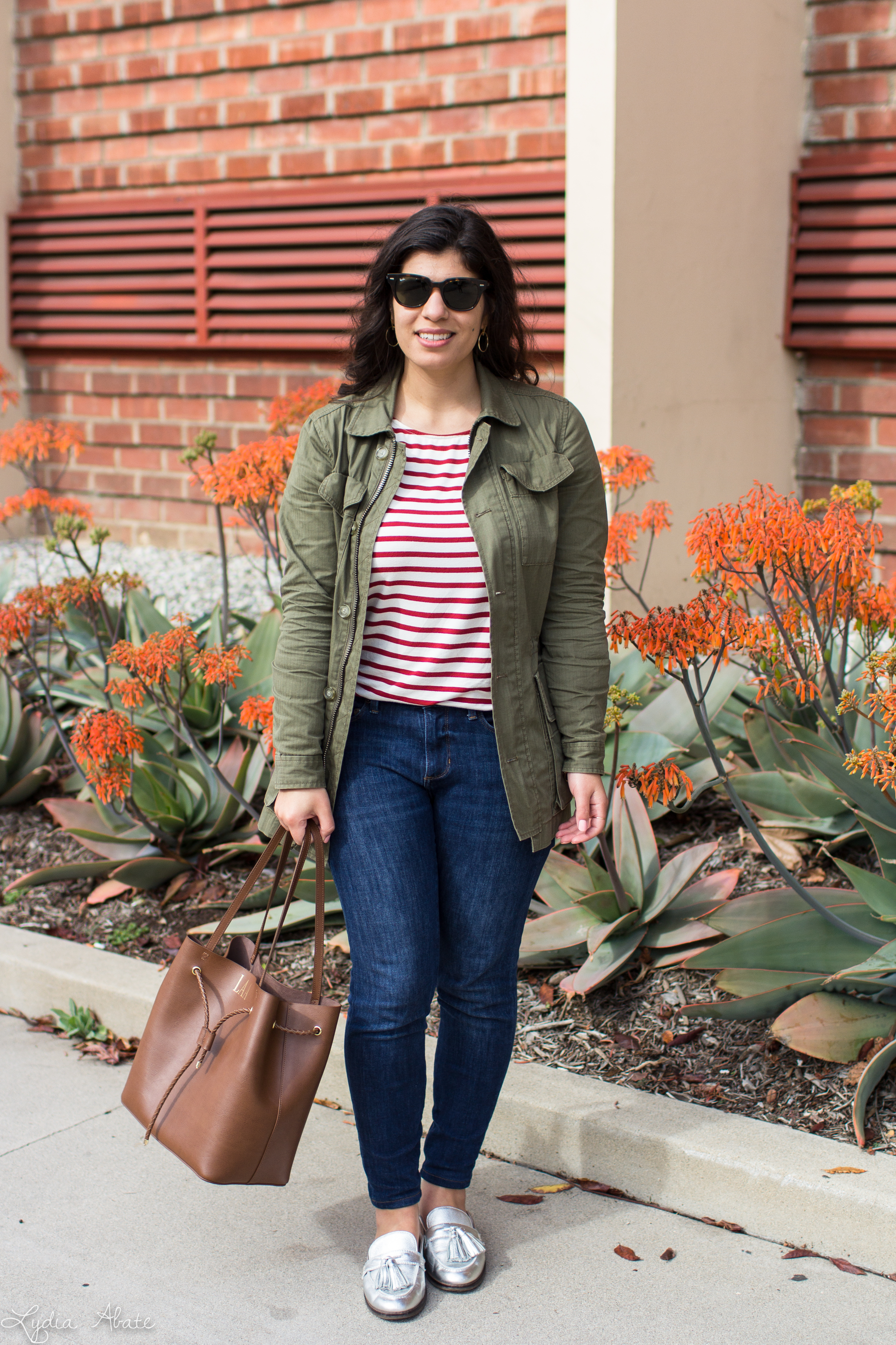 red and white striped top, field jacket, monogrammed bucket bag, silver loafers-7.jpg