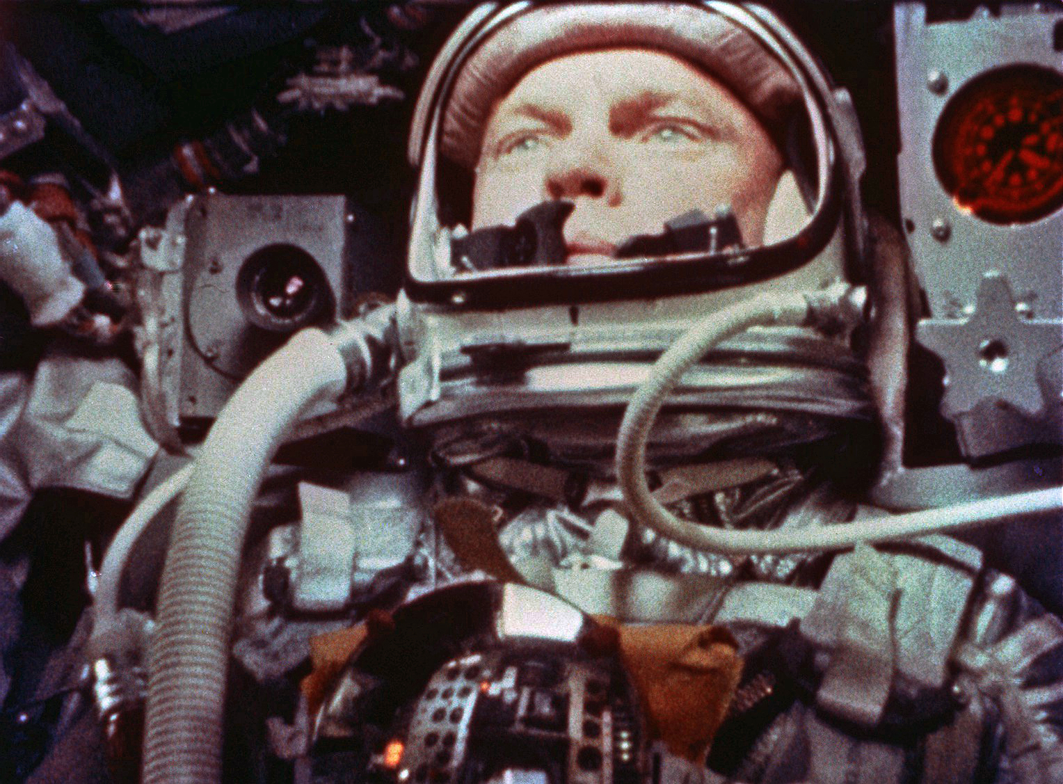 Still frame of John Glenn in orbit, taken by a motion picture camera inside Friendship 7 as he uses a photometer to view the sun during sunset on the MA-6 space flight (00304).