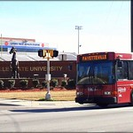FAST city bus passing Fayetteville State University 6 miles away from O2 Dental Group of Fayetteville