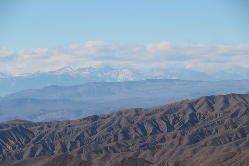 Zoomed-in view of cloud-shrouded Mount Whitney (left of center) and Mount Langley (left)