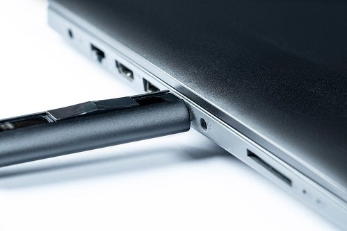 Flash memory drive plugged into a laptop port. | by wuestenigel