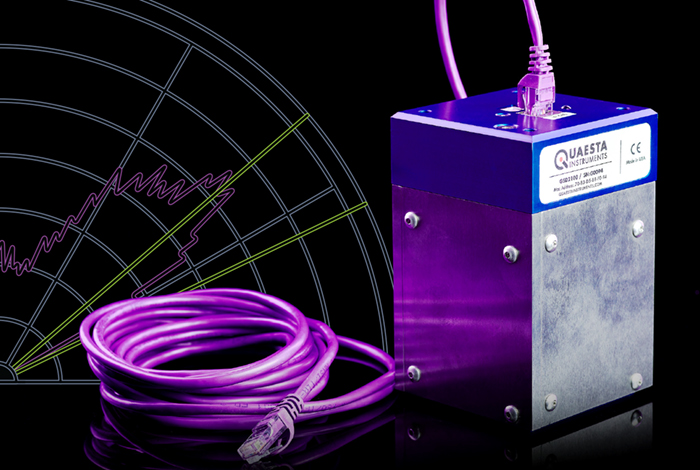 A radiation detector composed of a metal box with a purple cable connected to it.