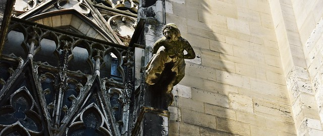 A gargoyle on the medieval Basilica of Saint Urban in Troyes, France in Troyes, France