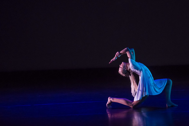 A dancer performs on stage during a production of Dancing Community.