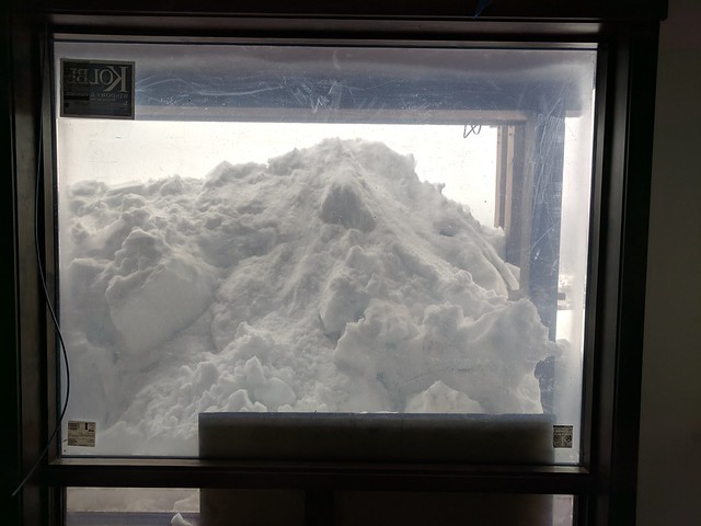 pile of snow through window