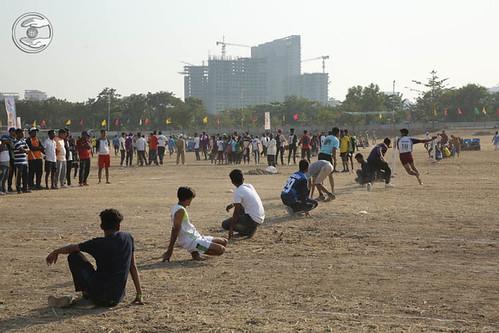 Devotees playing Kho-Kho