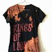 Women's Splatter Bleached and Shredded Kings of Leon Shirt Medium