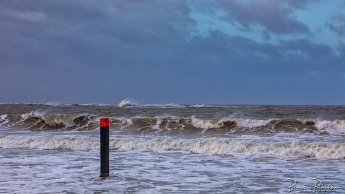 Beach Pole 13 Ouddorp on a windy day
