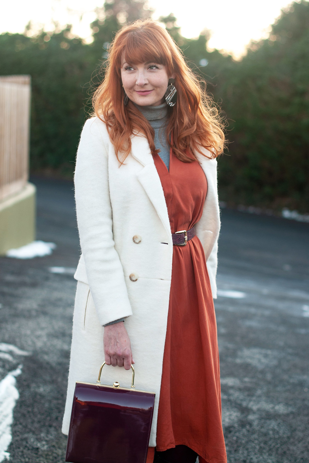 The Magic Powers of a Winter White Coat \ longline winter white wool coat \ burnt orange midi dress \ brown knee high boots \ grey roll neck | Not Dressed As Lamb, over 40 style blogger