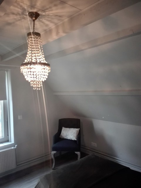 Fauteuil kroonluchter slaapkamer