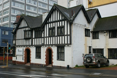"<p>...formerly McGavin House and Surgery; formerly The Red Cross Building <br /> <br /> 200 Willis Street is a good example of an Edwardian Tudor-style building designed by William Turnbull, a prominent local architect known for his skill in the design of revivalist buildings.<br /> The building with its distinctive black and white colour-scheme, eight sided corner tower and prominent gables, is a local landmark. The building forms part of the background to the superb timber gothic St Peter's Church nearby, and brings a human scale to the busy Willis/Ghuznee Sts intersection that is otherwise typified by large, modern commercial buildings. <br /> The building has a strong historic association with Sir Donald McGavin, a well-respected surgeon who was knighted for his work in WWI, and was used as his surgery and residence. <br /> The building also has an association with the New Zealand Red Cross, and with the United Industries Club, an organisation set up to provide facilities to young women who worked in industry as part of the ""war effort"" in WWII.<br /> Despite the render/paint coatings applied in 1944, the building has had few modern or intrusive alterations or additions, and retains most of the original building fabric. It carries a Heritage NZ 'Historic Place Category 1' Listing (No.1342).</p>"