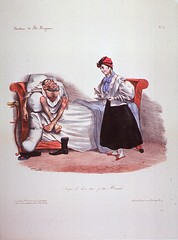 Woman bringing food to a man in bed