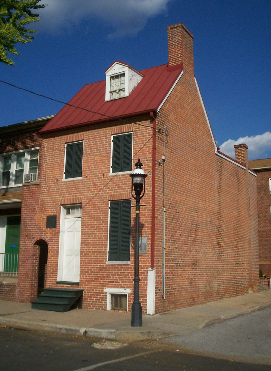 The Edgar Allan Poe House and Museum, located at 203 North Amity St. in Baltimore, Maryland, is the former home of American writer Edgar Allan Poe in the 1830s. The small unassuming structure, which was opened as a writer's house museum in 1949, is a typical row home. It was designated a National Historic Landmark in 1972. Due to a loss of funding by the city of Baltimore, the Museum closed to the public in October 2012. Poe Baltimore, the Museum's new governing body, reopened the Museum to the public on October 5, 2013. Poe's bedroom is believed to have been on the third floor. Photo taken by <a href=
