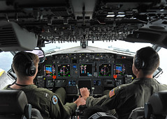 Lt. j.g. Bryan Hunt, left, and Lt. j.g. Matt Johnston, both attached to Patrol Squadron 47, conduct flight operations in a P-8A Poseidon during a CMPOP exercise with the Japan Maritime Self-Defense Force over the East China Sea, Jan. 30. (U.S. Navy/MC1 Kevin A. Flinn)