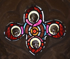 Quatrefoil of cherubs 'with heads of African boys' (Heaton, Butler & Bayne, 1874)
