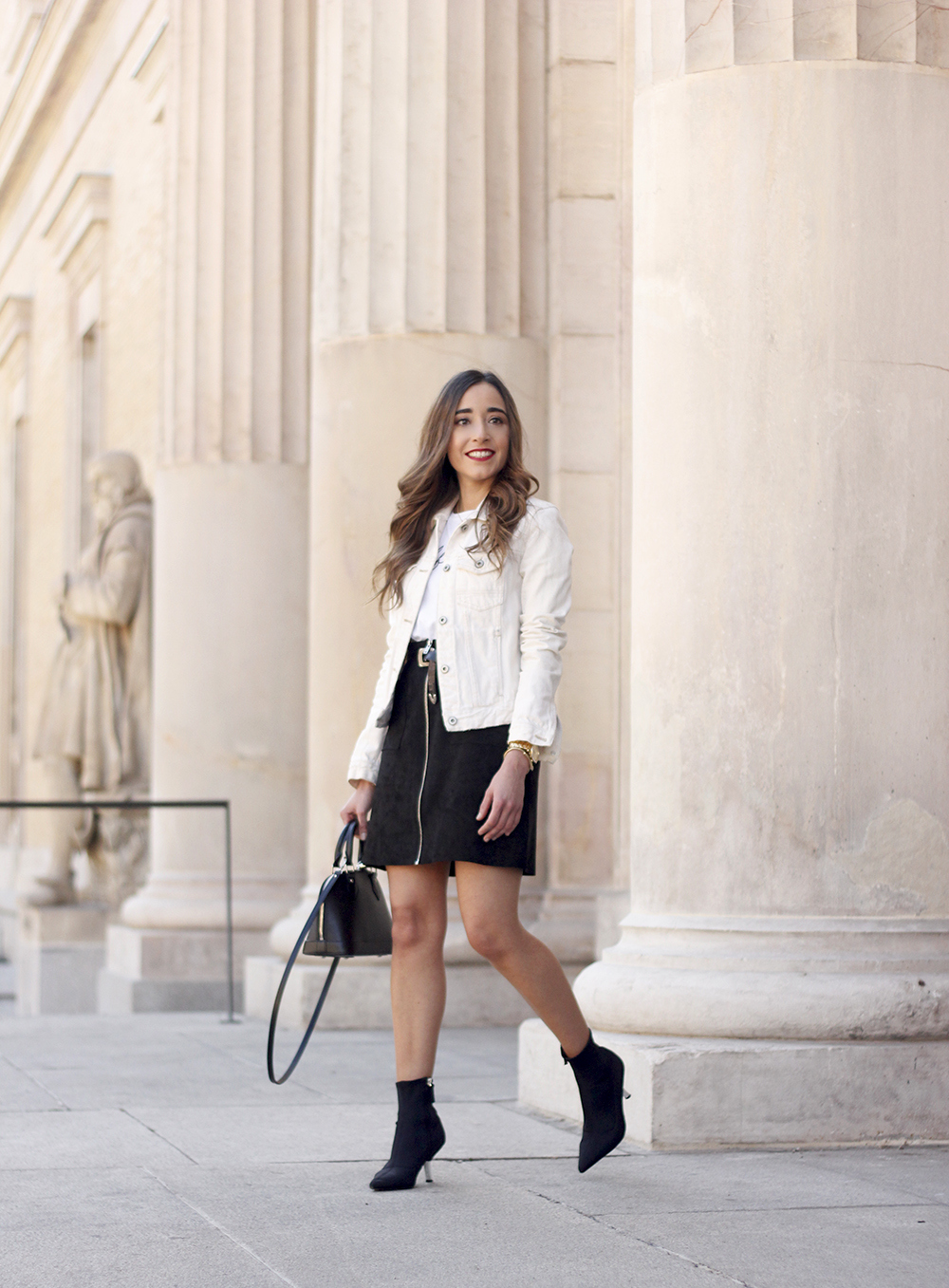 suede black skirt uterqüe ankle boots denim jacket louis vuitton bag street style outfit 20195