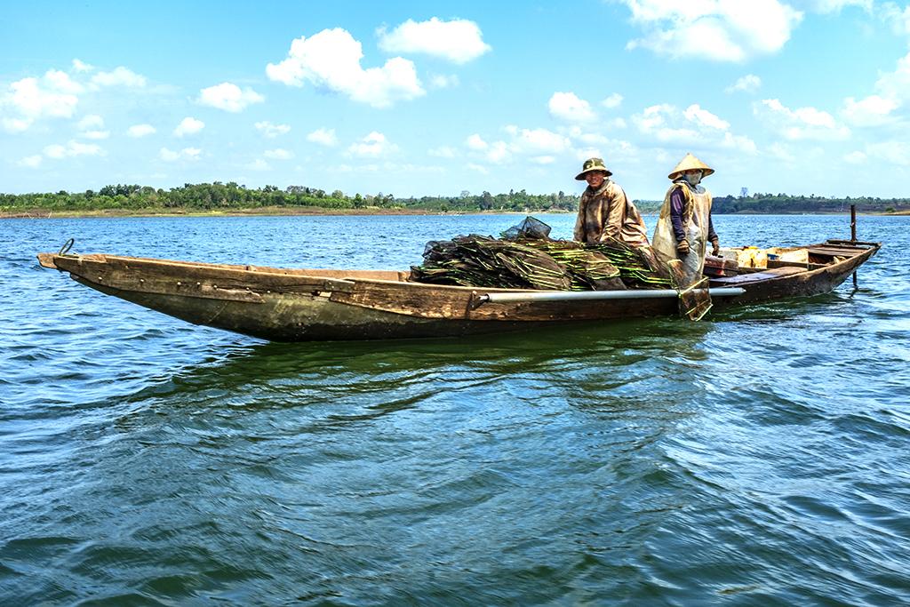 Fisherman on his boat--Krong Buk