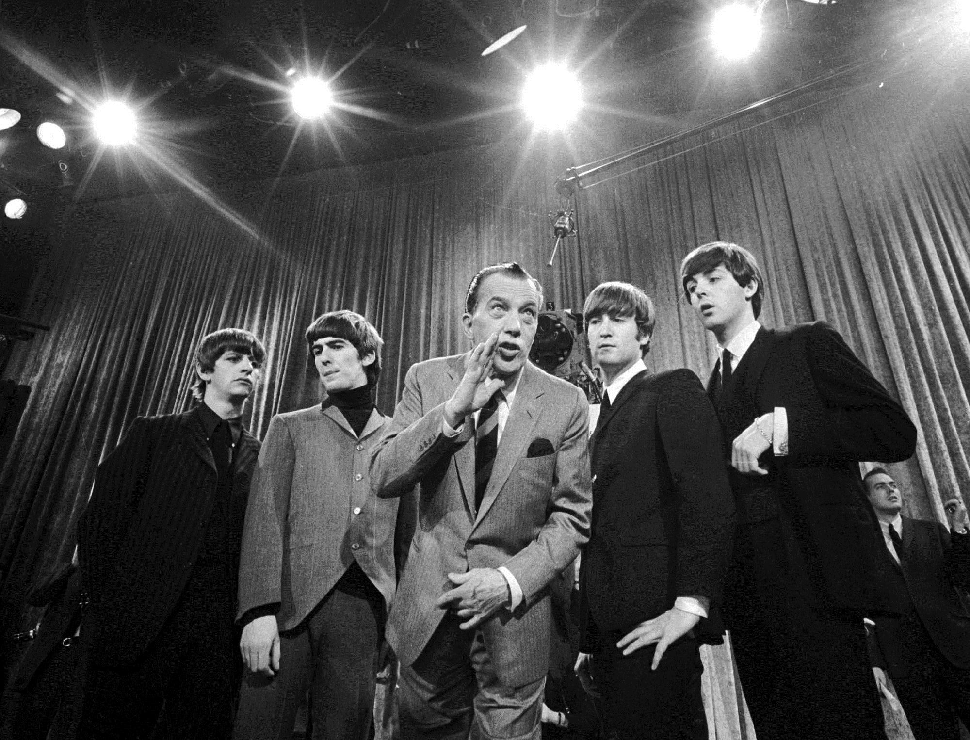 The Beatles and Ed Sullivan, February 1964. Left to right: Ringo Starr, George Harrison, Ed Sullivan, John Lennon, Paul McCartney