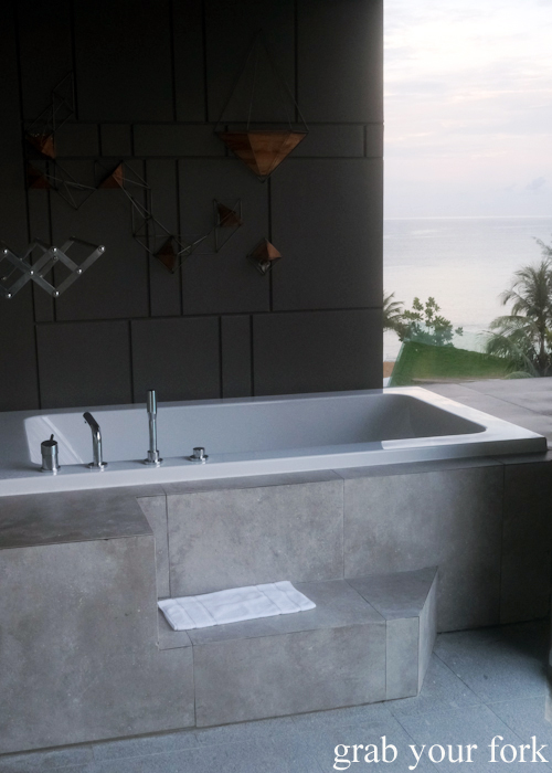 Outdoor bathtub with ocean view at La Vela Hotel Resort in Khao Lak, Thailand