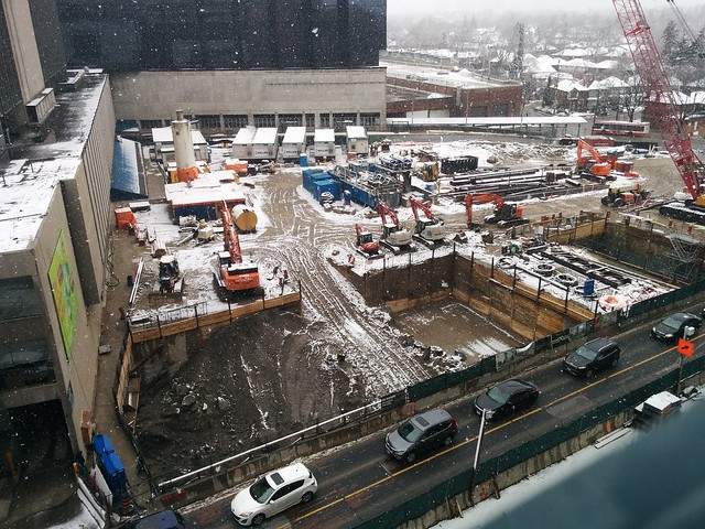 Looking down on Eglinton Station #toronto #yongeandeglinton #yongeeglintoncentre #spring #snow #eglintonavenue #eglintoncrosstown #eglintonstation #cranes