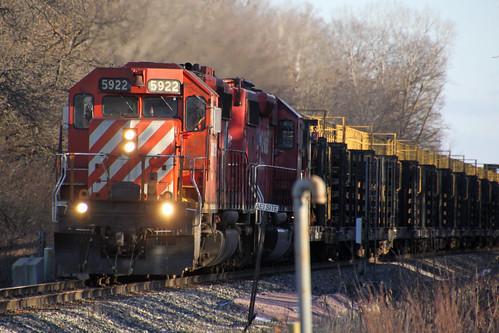 CP 5922 leads a Dual Flags sister on a westbound rail train coming into Portage
