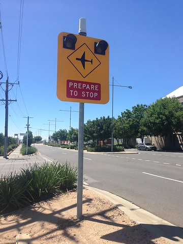 Sign for vehicles approaching aircraft level crossing, Essendon Airport