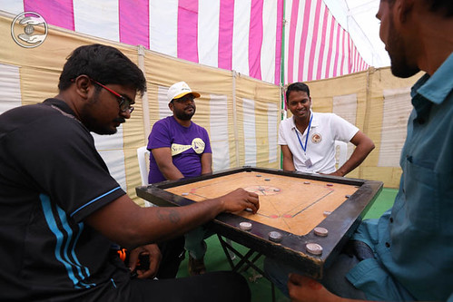 Devotees playing Carrom-board