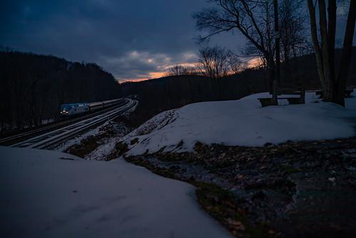 07t amtk99 amtrak amtrakpennsylvanian cassandraoverlook ns07t pennsylvanian snow sunset train winter creek dusk leaves naturalspring overlook railfan railfanoverlook railroad spring water