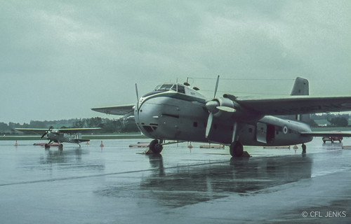 1965 NZ5912 with an Auster at Whenuapai, Auckland