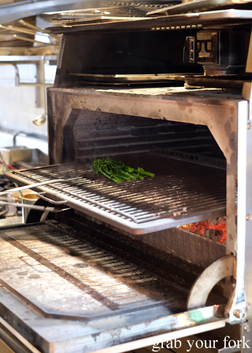 Broccolini in the Josper charcoal oven at Totti's by Merivale in Bondi