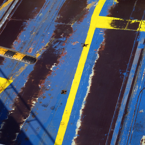 The car deck on a ferry to Sweden is painted the yellow and blue of the Swedish flag