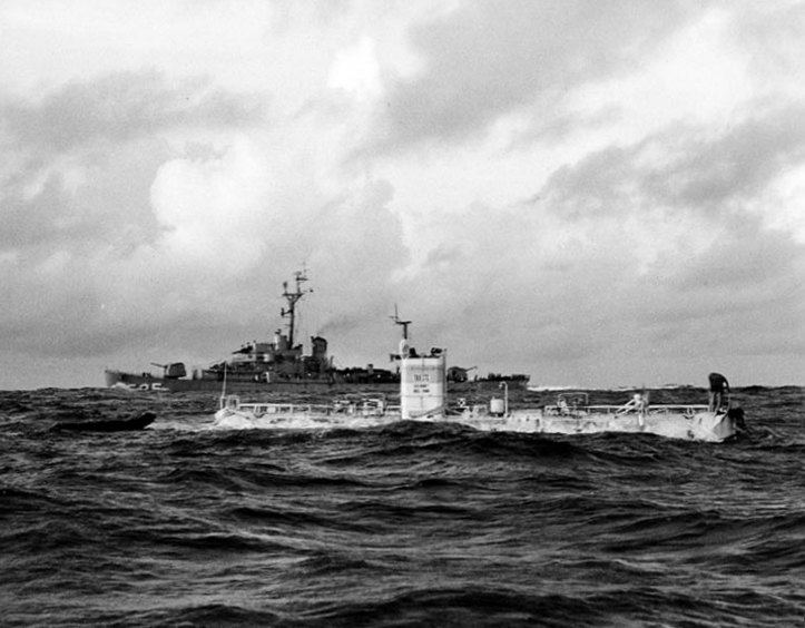 U.S. Navy Bathyscaphe Trieste, just before her record dive to the bottom of the Marianas Trench, January 23, 1960. USS Lewis (DE-535) is steaming by in the background. U.S. Naval Historical Center Photograph #NH 96797