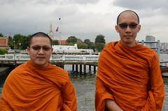 Two of Wat Kanlayanamit's resident monks chill out by the riverside