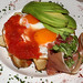 Estrellados: Two fried eggs over golden potatoes with Serrano ham and fresh tomato and olive oil sauce