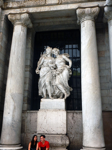 A statue of two women is part of the Neo-Classical exterior of Palacio of Bellas Artes in Mexico City