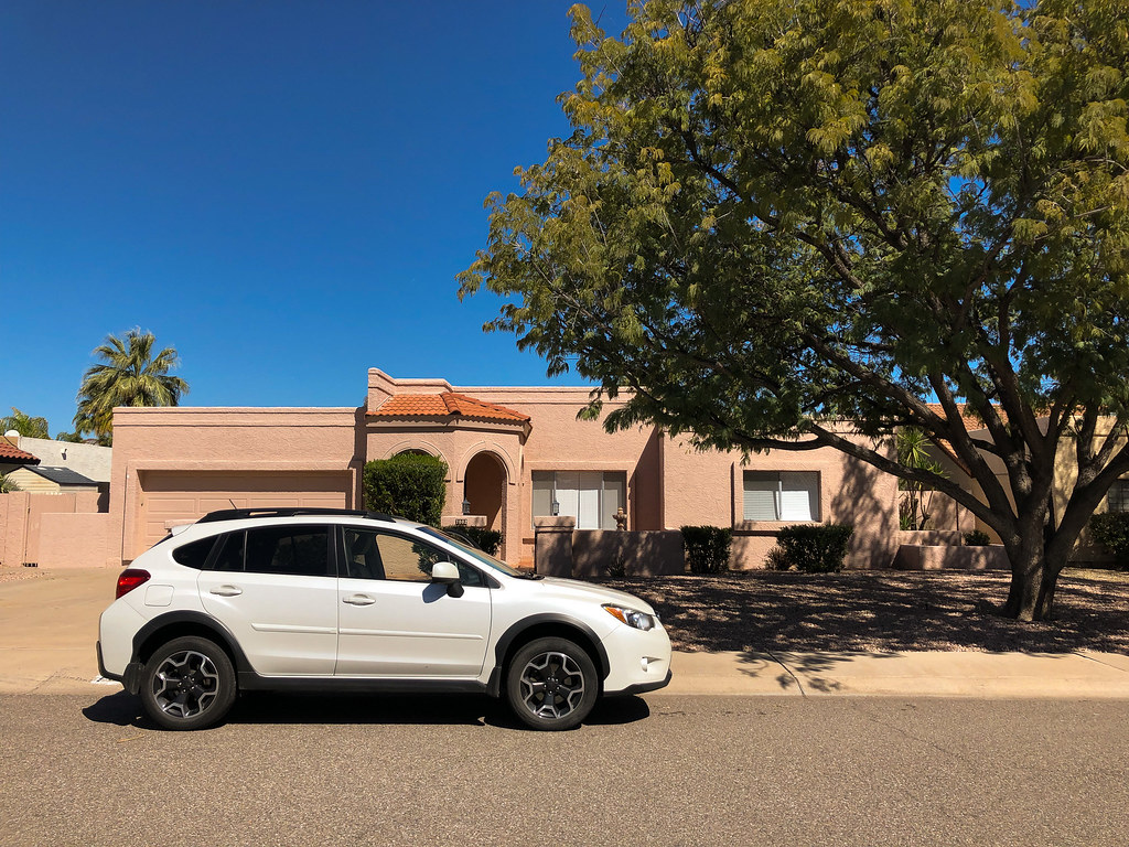My white 2013 Subaru XV Crosstrek Limited is parked in front of our rental house in Scottsdale, Arizona