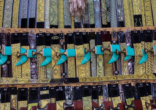 Belts and janbiya daggers for sale in a shop, Najran Province, Najran, Saudi Arabia