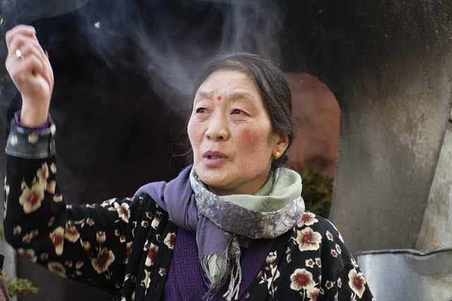 Pilgrim in front of Dé Gönkhang monastery, Tibet 2018