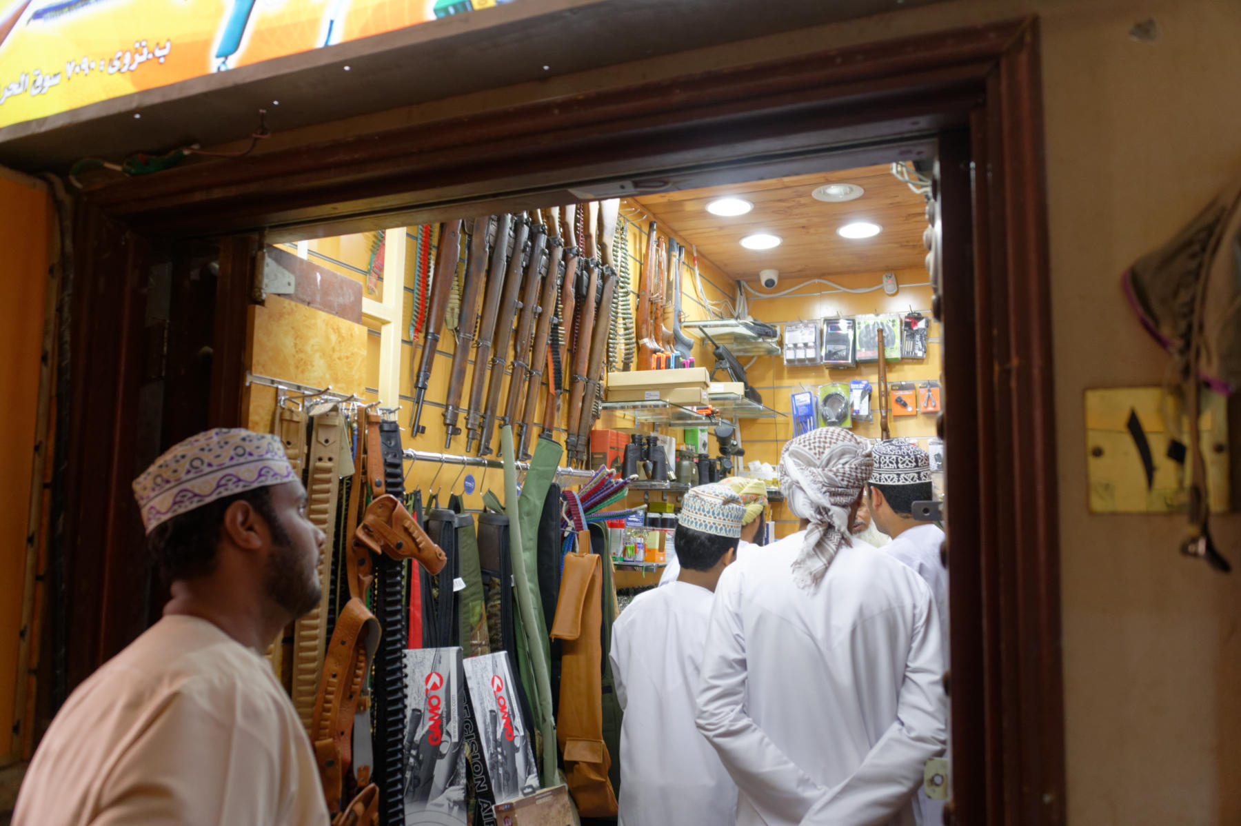 Selling guns in Nizwa Souq, Oman