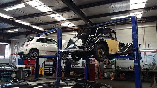 An Abarth and an Alvis on the hoists for inspection