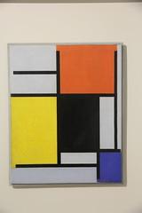compositie met rood, geel, zwart,  blauw en grijs