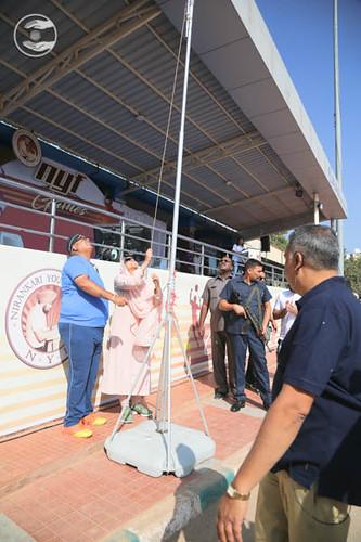 Satguru Mata Ji hoisting the white flag, A symbol of Love Peace and Unity