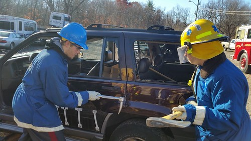 Students learn how to extricate injured individuals from a car.