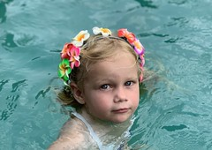 Madeleine in the pool today with new flower band in her hair