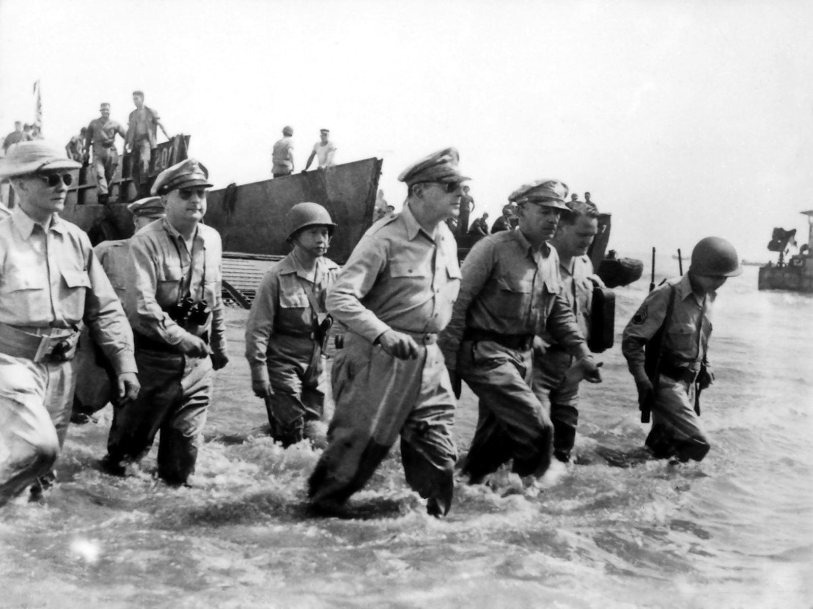 U.S. General Douglas MacArthur wades ashore during initial landings at Leyte, Philippine Islands, on October 20, 1944. Photo taken by U.S. Army Signal Corps officer Gaetano Faillace.