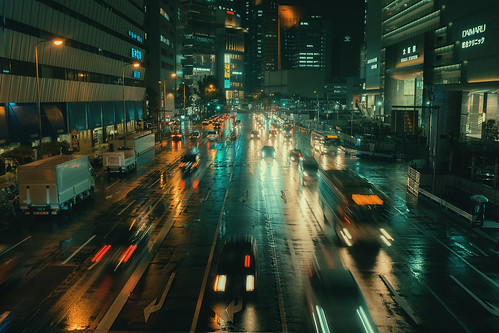Somewhere in Umeda, streaks of light passed by the wet pavement