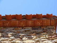 Génoises décorées au lait de chaux. Ce sont des tuiles de débord des toits. (dont les décors géométriques devaient sans doute protéger du mauvais sort) - Photo of Saint-Féliu-d'Amont